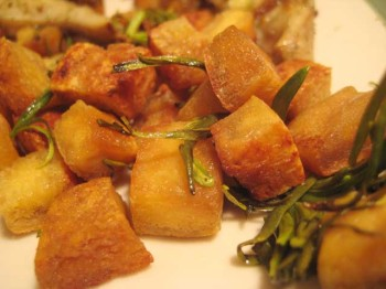 Pan-fried tofu cubes with black greasewood leaves.