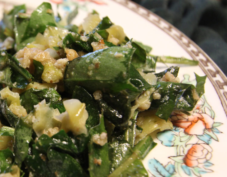 Oven-wilted Shasta daisy and dandelion greens with yucca antipasto and walnuts makes a good side dish.
